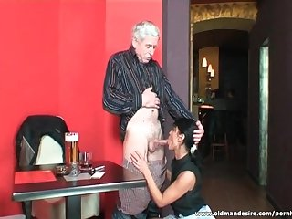 Alluring waitress sucks fat old cock