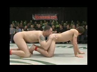 Four naked fighters fight in front of a screaming audience