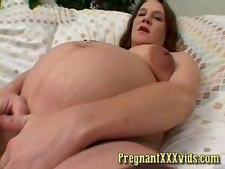 Pussy rubbing pregnant milf