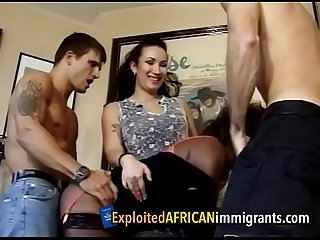 Mature african immigrant women forced to serve white cock in A foursome period