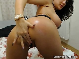 Busty cam girl toys her pussy and ass