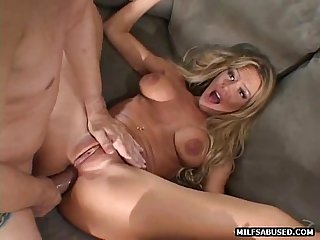 This sexy blonde big tit milf is getting fucked in her pussy