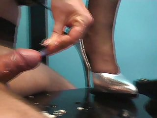 Mistress inserting toothrbush in a guy s cock while she jerks and makes him cum