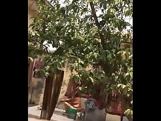 Desi Bhabhi Outdoor Shower Secretly Filmed By Neighbour - IndianHiddenCams.com