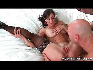 Extreme brunette milf with huge boobs